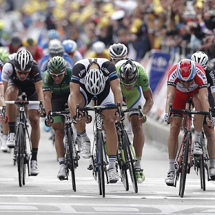 Marcel Kittel, centre right, crosses the finish line ahead of Alexander Kristoff and Arnaud Demare (AP)