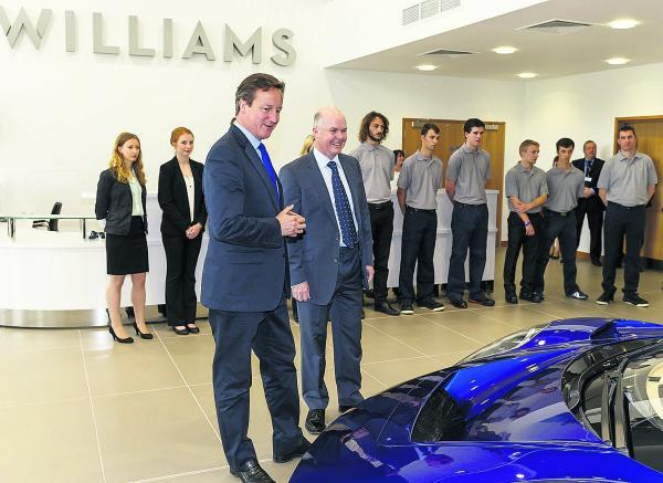 David Cameron is shown around the Williams facility by the team's Advanced En