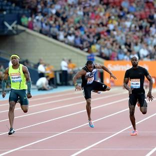 Yohan Blake, centre, has received a fitness boost after pulling up injured in the 100 metres in Glasgow