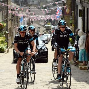 Team Sky manager Sir Dave Brailsford has backed Richie Porte, left, to deliver a third consecutive Tour de France title for the team