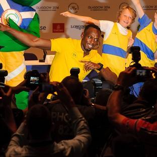 Usain Bolt, centre, had a lively press conference upon his arrival in Glasgow