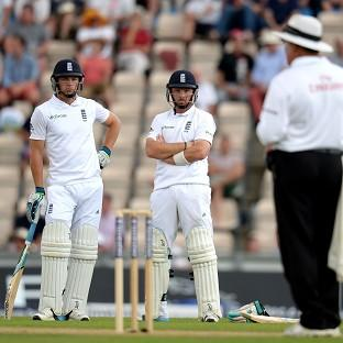 Jos Buttler, left, and Ian Bell, right, were among the runs for England on Monday