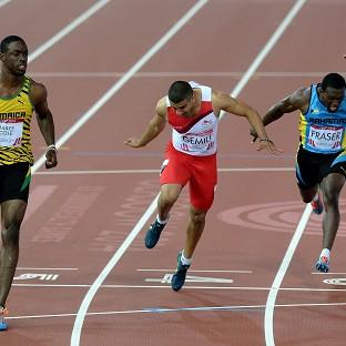 Adam Gemili, middle, took silver in the 100m final