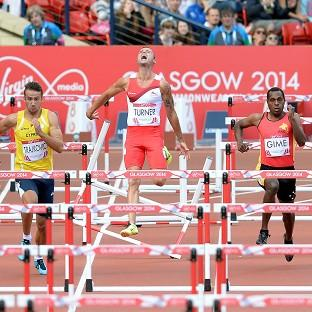 Andy Turner, centre, crashes out of his heat in the 110m hurdles