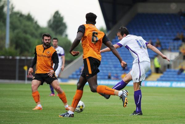 Oxford United's Danny Hylton lets fly, but his shot was saved by Wolves keeper Aaron McCarey