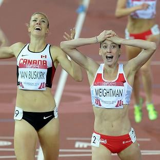 Laura Weightman, right, reacts to her silver