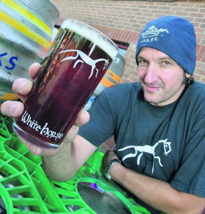 Steven McCormack, of White Horse Brewery in Stanford in the Vale, pictured with one of his brews. Pictures: OX68909 Simon Williams