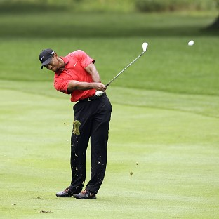 Tiger Woods was forced to pull out of the WGC-Bridgestone Invitational with a back injury (AP)