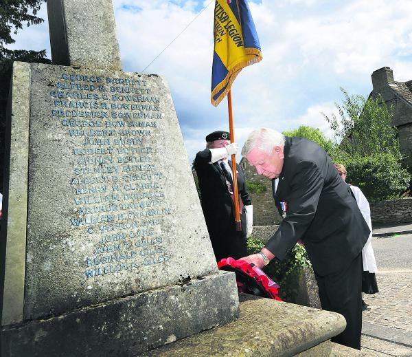 Kidlington Royal British Legion chairman Stan White lays a wreath at the village memorial