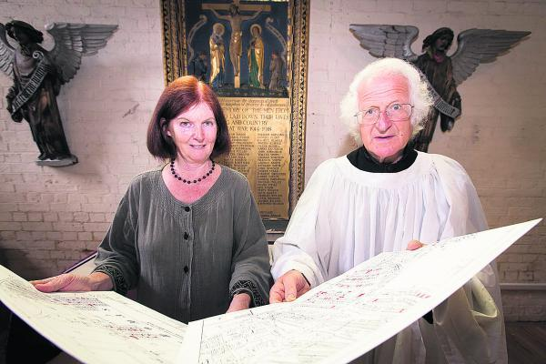 HISTORY: Churchwarden Anne James and the Rev Prof Martin Henig with a map of the Osney area showing the homes of soldiers who were killed during the First World War