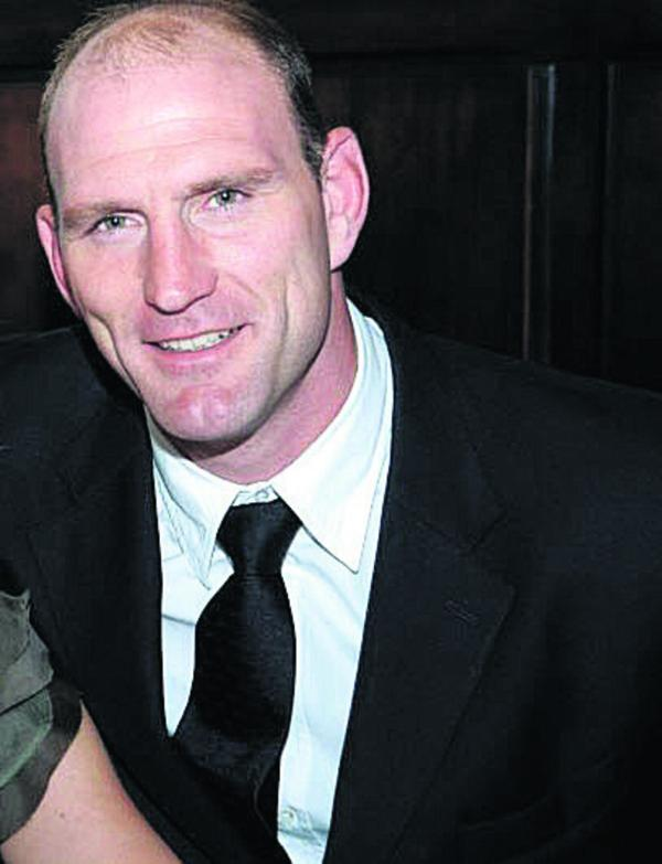 Rugby player Lawrence Dallaglio has joined the fight to provide better NHS treatment for cancer sufferers