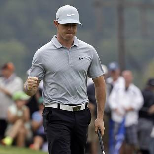 Rory McIlory climbed to the top of the leaderboard on Friday (AP)