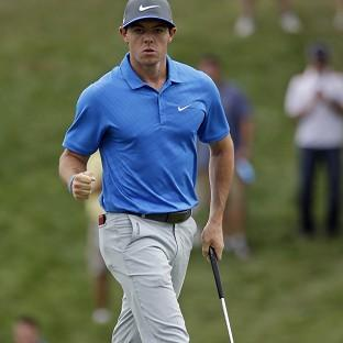 Rory McIlroy had to display his battling qualities to retain a lead (AP)