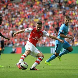 Aaron Ramsey scored Arsenal's second as they laid down an early marker