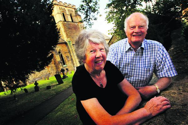 Ron and Diana Cosford outside St Mary's Church in Iffley