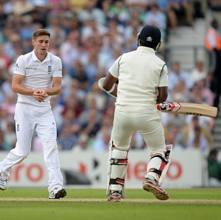 Chris Woakes takes a catch off his own bowling to dismiss Varun Aaron