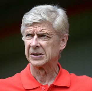 Arsene Wenger, pictured, was not happy with the decision to send Aaron Ramsey off