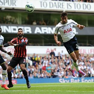 Tottenham's Nacer Chadli, right, heads in his side's third goal against QPR
