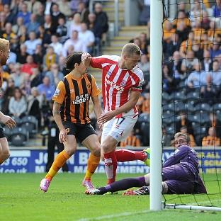 Ryan Shawcross, centre, scores Stoke's equaliser against Hull City