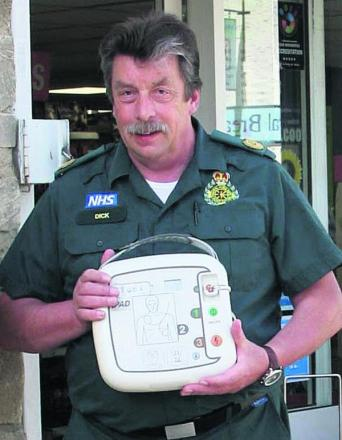 Dick Tracey with a defibrillator which has been installed in Eynsham