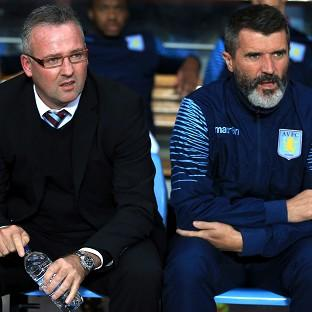 Paul Lambert, left, saw his side humbled by lowe