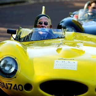 Sir Stirling Moss drives a 1959 Jaguar D-type Le Mans