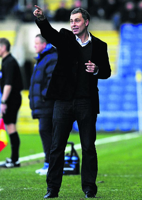 Wayne Burnett believes Oxford United are in a false position in the table