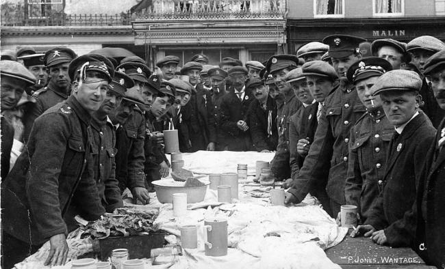 Soldiers at a welcome home celebration tea in the Market Place, Wantage, in 1914