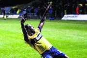 Tyrone Barnett celebrates his last-minute winner against Bury on Saturday, the last game of the striker's loan spell at Oxford