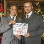 Banbury Cake: George Clooney, left, swaps Hollywood for Highclere Castle on the set of Downton Abbey alongside co-star Hugh Bonneville