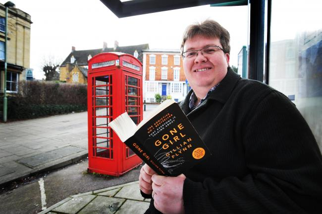 Great news: Tim Tarby-Donald, who runs the Visit Banbury website, outside the phone box library