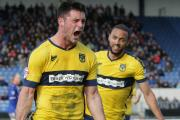 Patrick Hoban celebrates scoring his first goal for Oxford United in his 13th start, with teammate Kemar Roofe