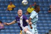 Andy Whing (left) in action against Coventry City during a pre-season friendly in 2013