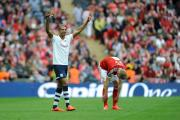 Jermaine Beckford celebrates, while Michael Smith can't look