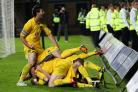 Oxford United skipper Jake Wright (left) shows how much a derby win means to him after Alfie Potter scored an 88th-minute winner the last time they faced Swindon Town in 2012