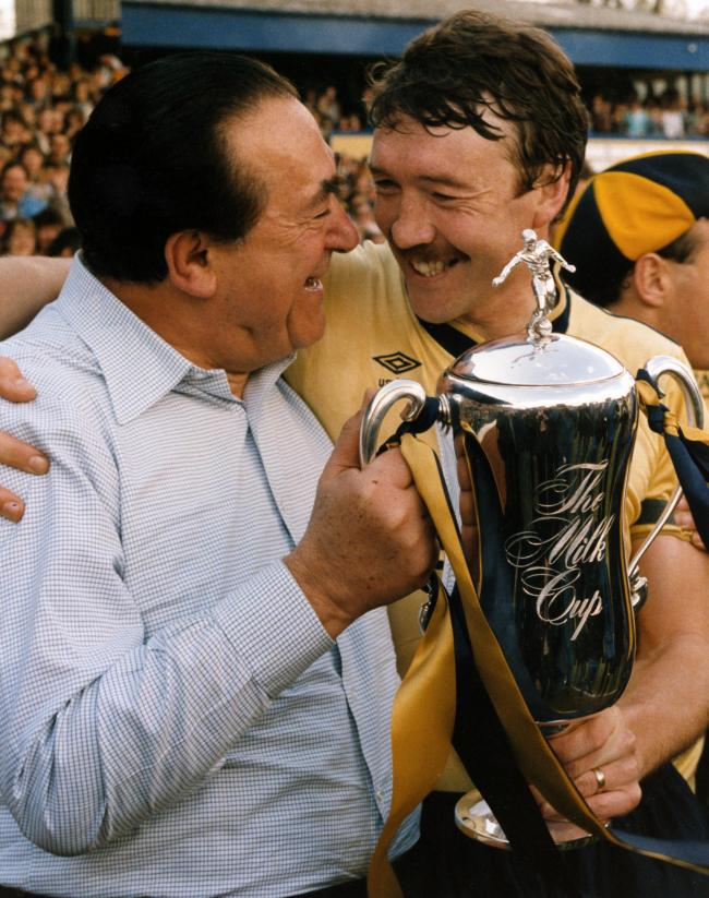 GLORY DAYS: Malcolm Shotton holds the Milk Cup with chairman Robert Maxwell in 1986