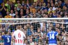 Leighton Baines' penalty rebounded into the net off Shay Given
