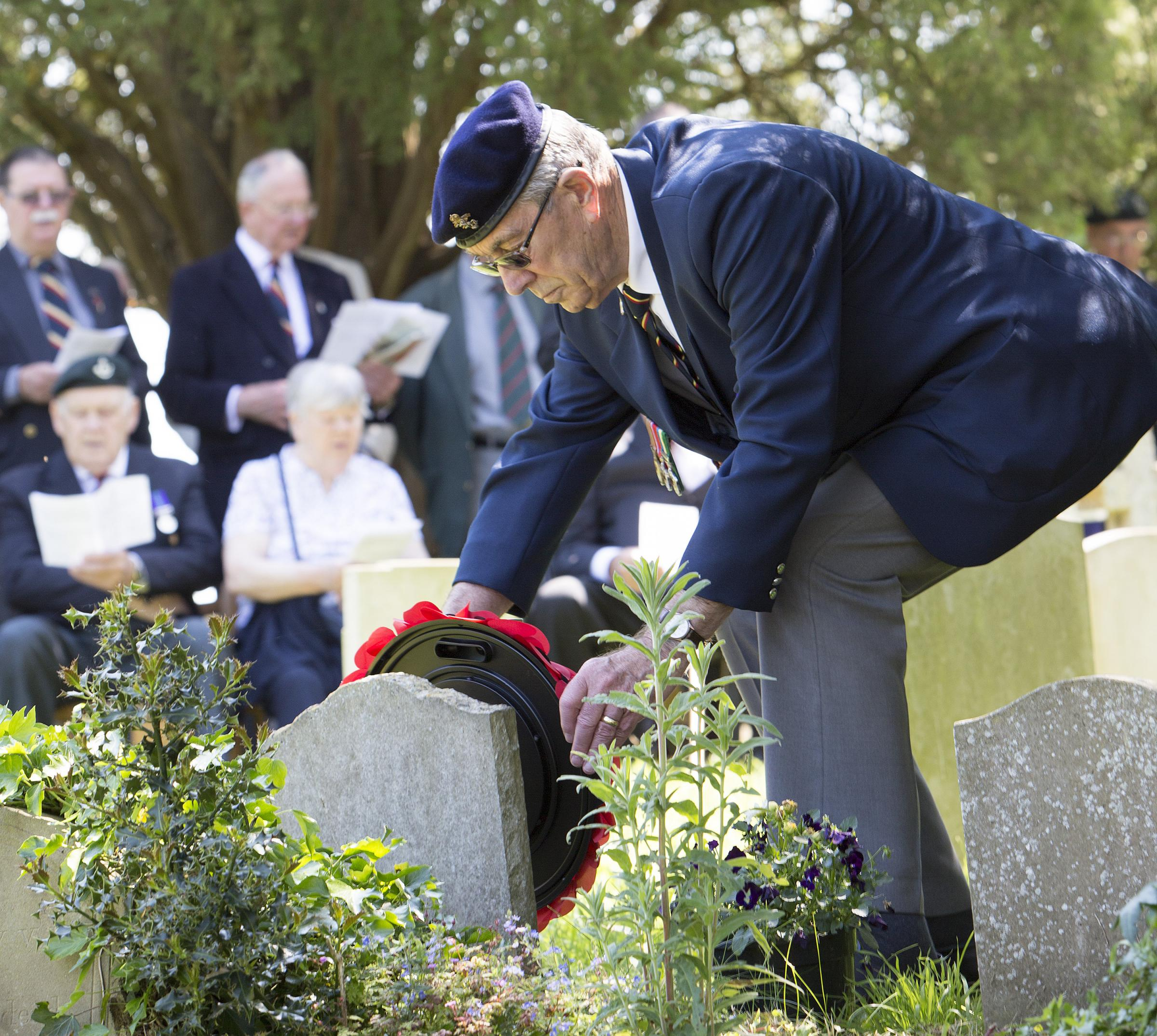 Major John Howard's second cousin Derek Chivers lays a wreath at his grave. Picture Damian Halliwell