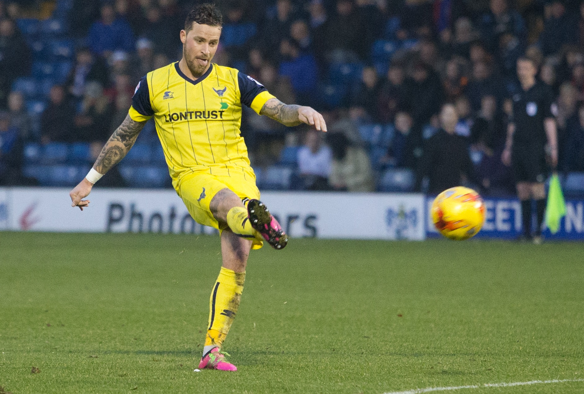 Chris Maguire scores his second free-kick in Oxford United's 3-2 win at Bury last season. The forward will line up for the Shakers tonight looking for his first goal of the campaign Picture: James Williamson