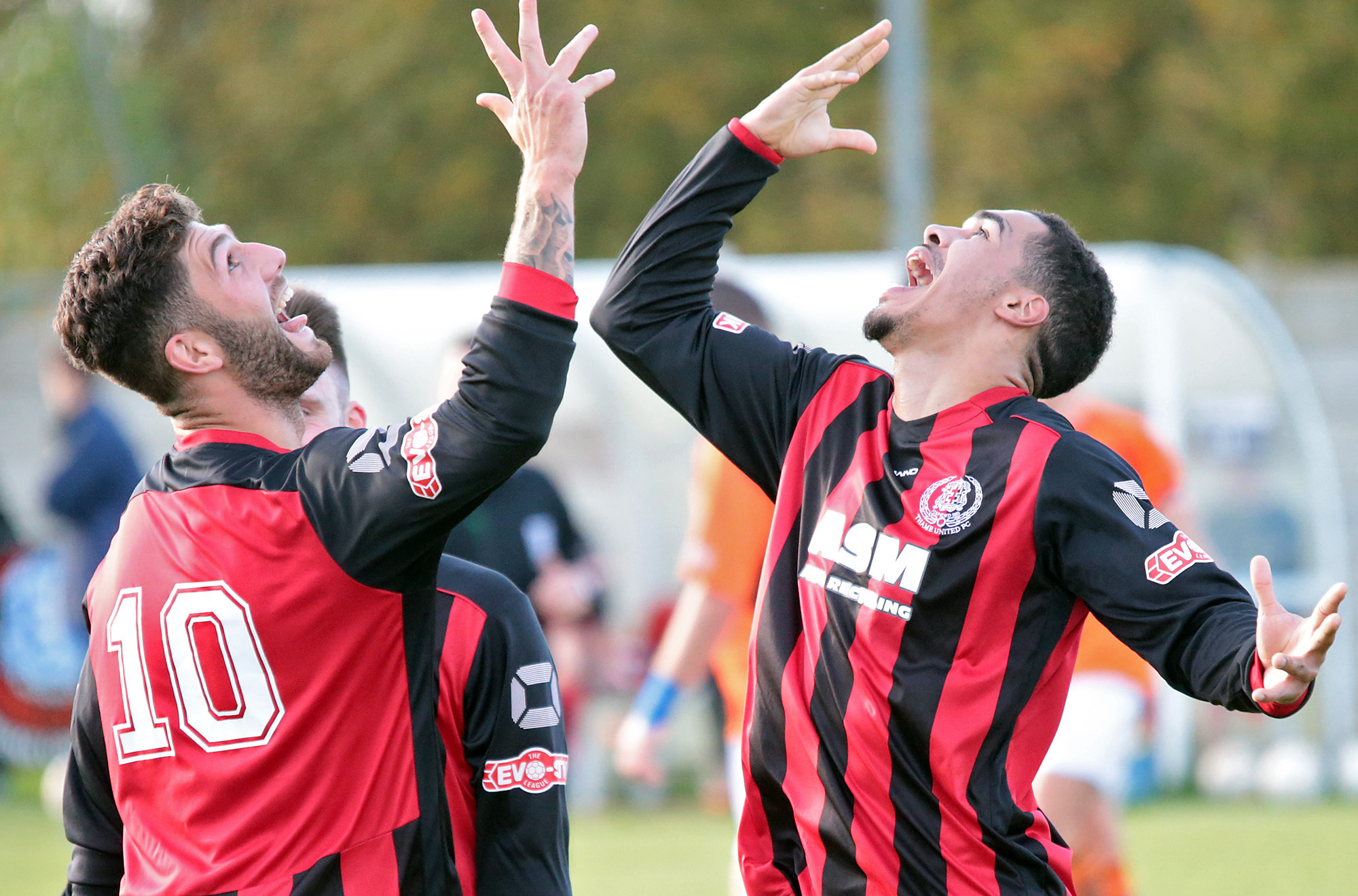 Lynton Goss celebrates his hat-trick with strike partner Dan West (10) in Thame's 5-0 win against Wimborne Picture: Ric Mellis