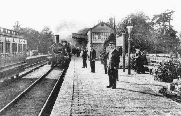 Banbury Cake: A 2-2-2 GWR single-wheeler enters Witney station in about 1912, with a train from Fairford to Oxford.