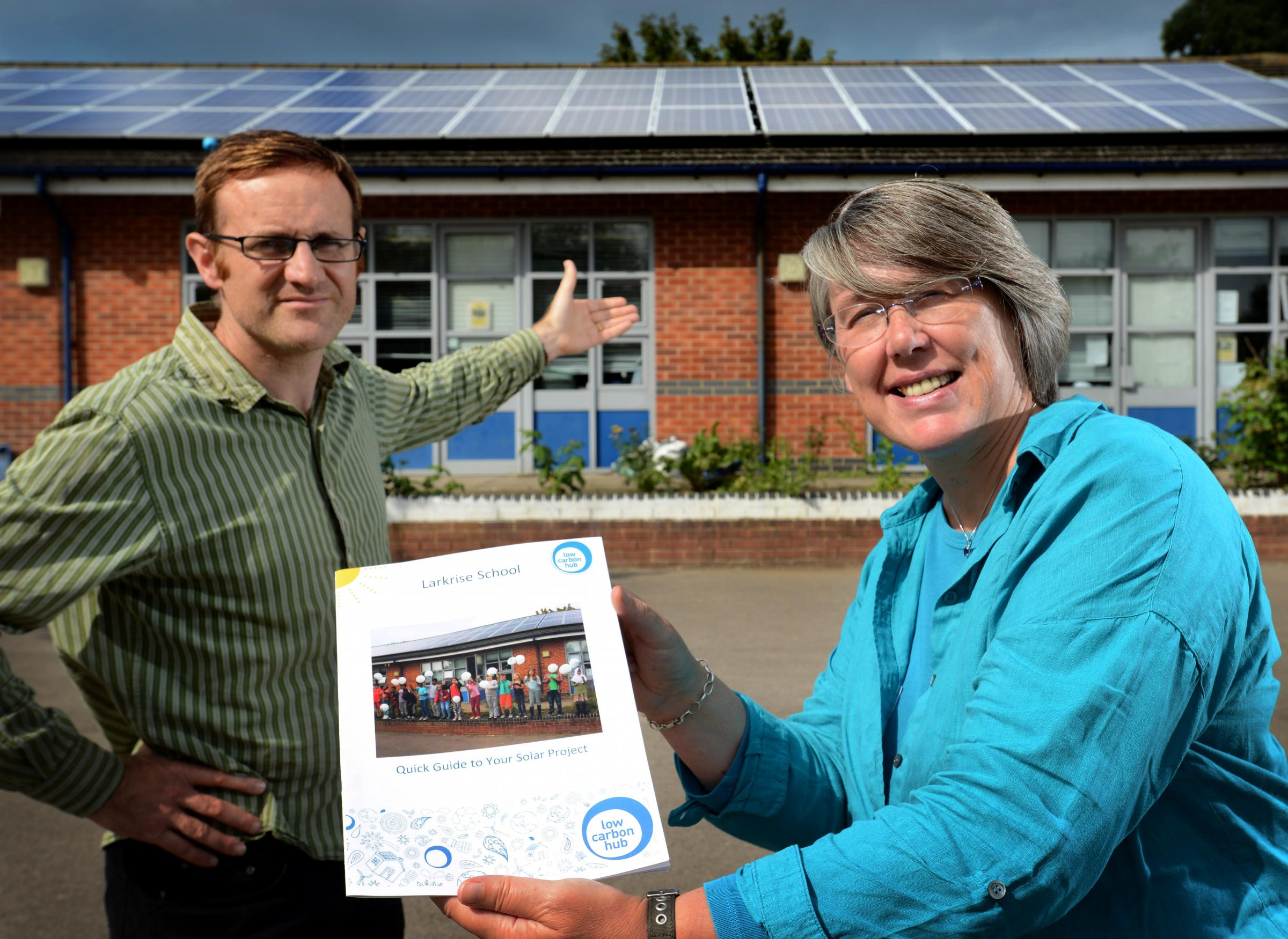 Low Carbon Hub CEO Barbara Hammond, right, with the hub's solar panel installation at Larkrise School and teacher Ed Finch. Picture: Richard Cave