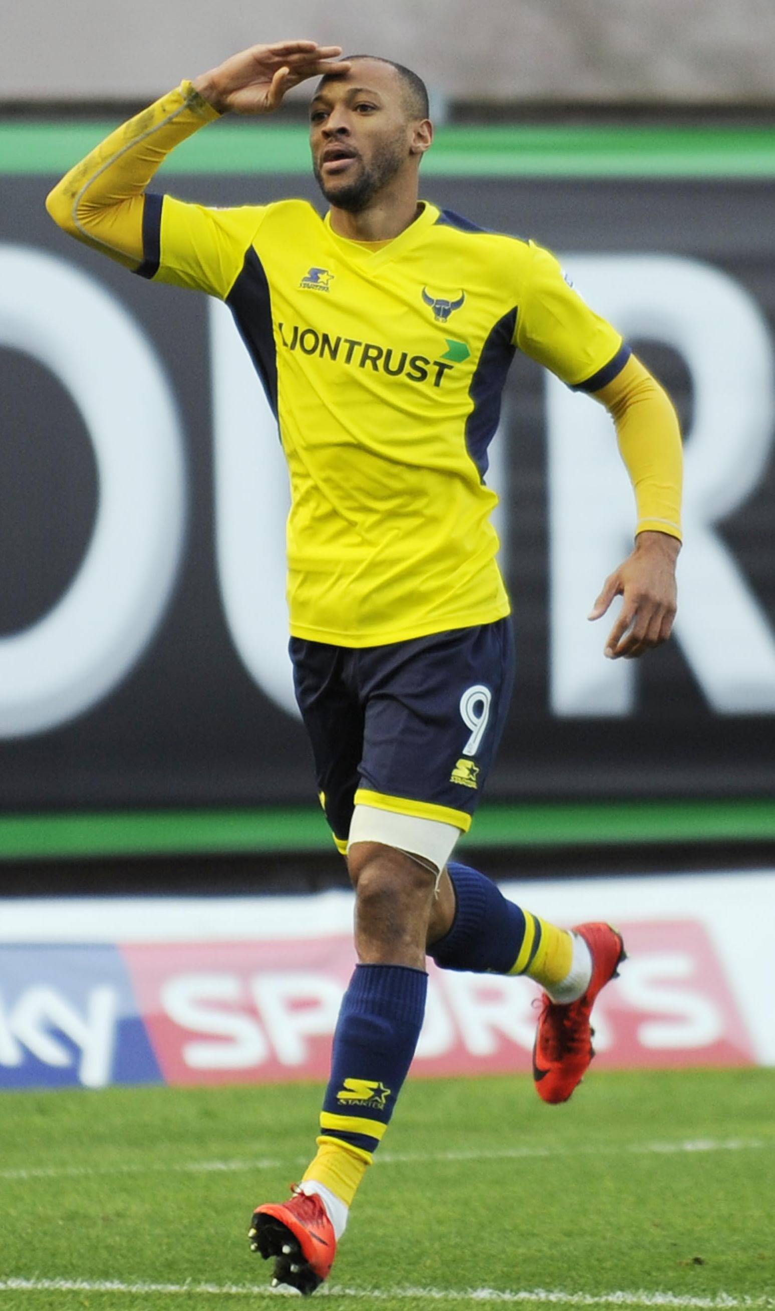 UP AND RUNNING: Wes Thomas celebrates his opening goal for Oxford United against Milton Keynes Dons Picture: David Fleming