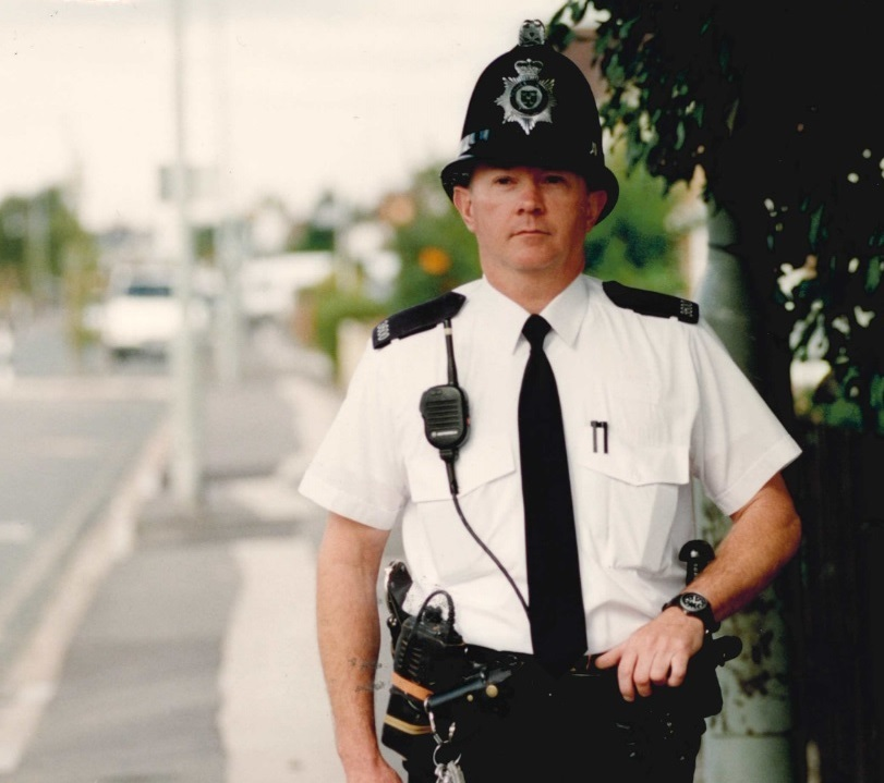PC John Mitchell dons a police helmet in 2001 Pic: Damian Halliwell