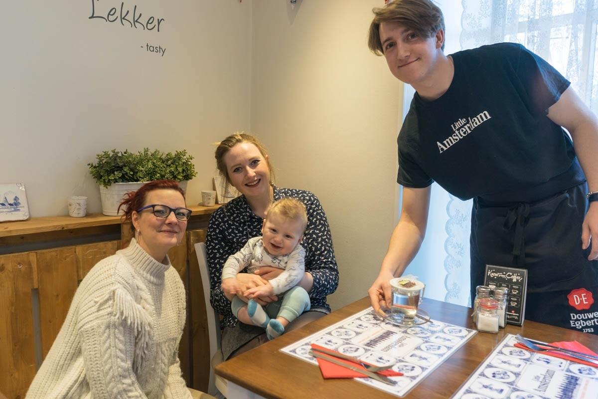 (L-R) Ilja Abbattista, founder of Little Amsterdam Cafe with cutomer Hayley Fiddler, her son Jonah Stevenson and Satya Hayes