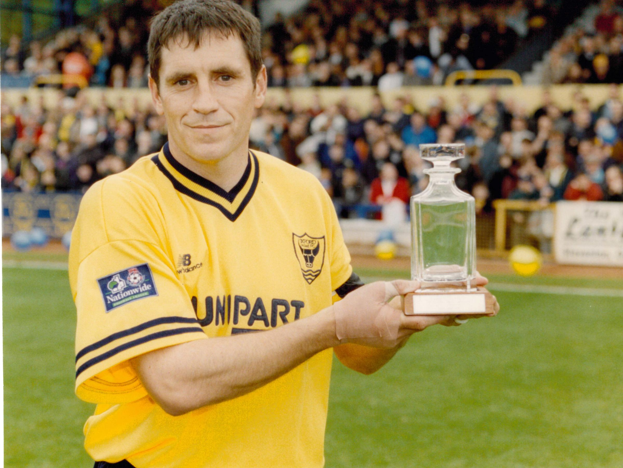 HONOURED: Les Robinson with a trophy presented for his 500th Oxford United league appearance in 1999