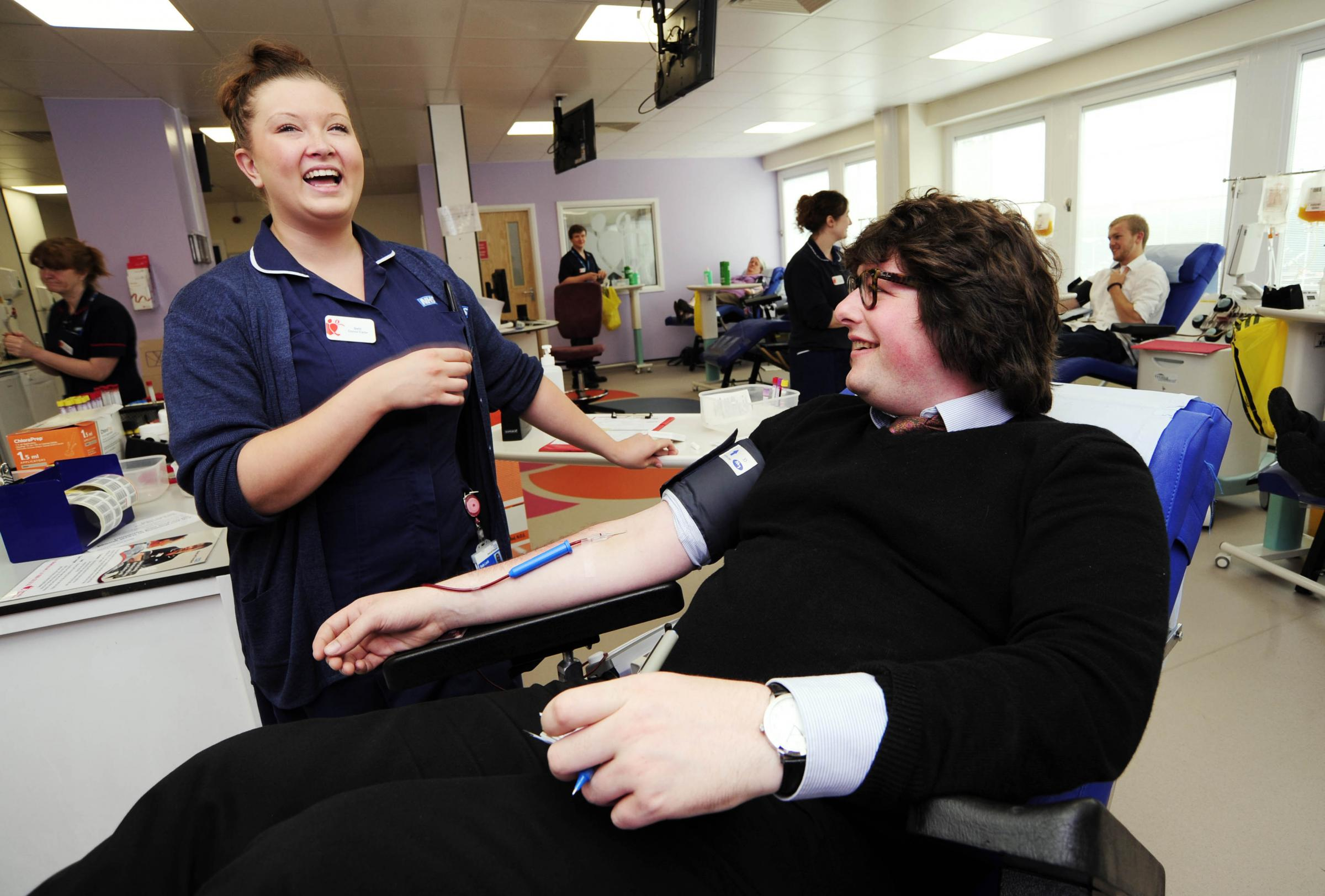 Former Oxford Mail reporter Alex Regan giving blood under the care of Beth Lock. Picture: David Fleming