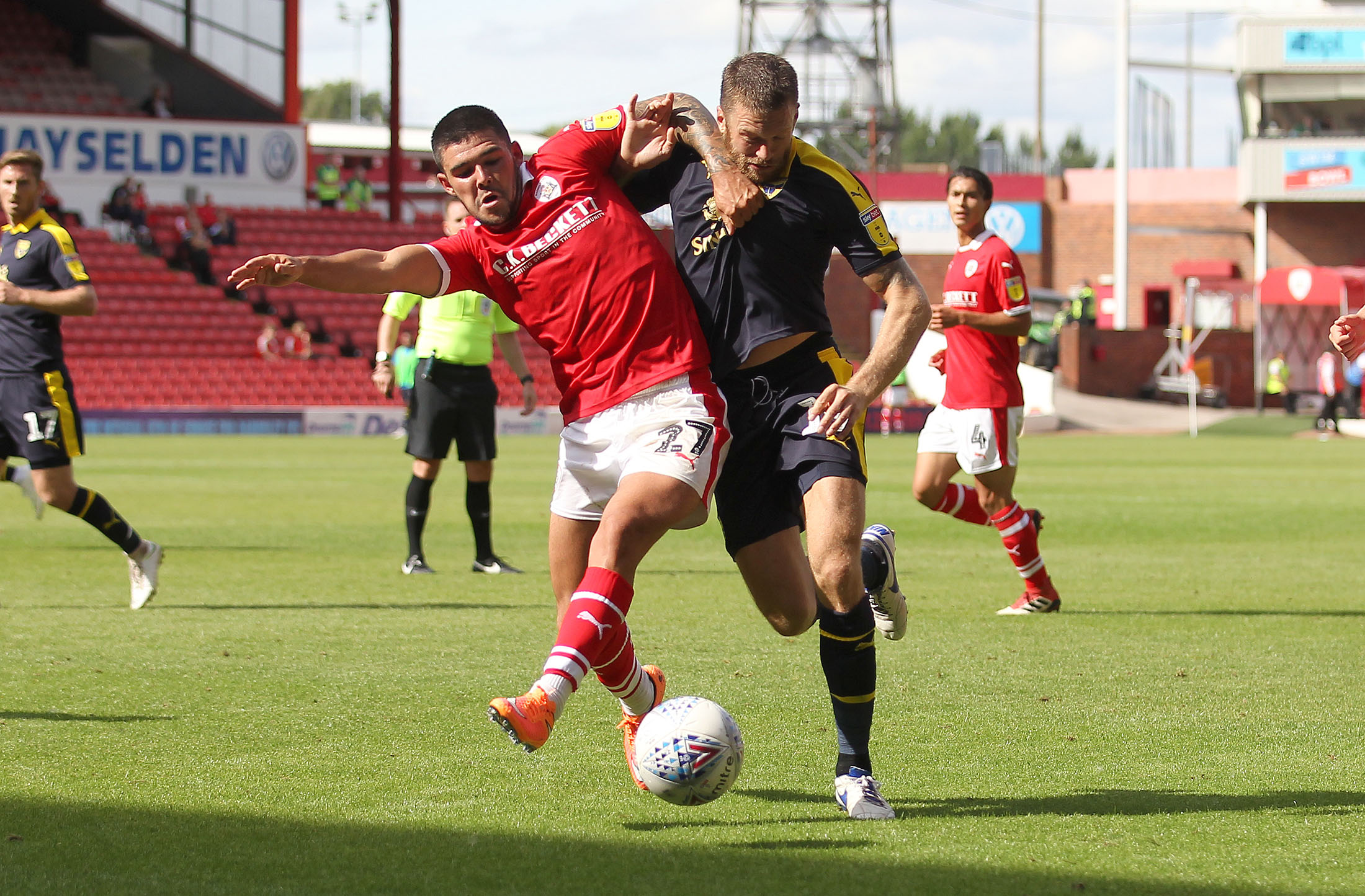 Former Oxford United loanee Alex Mowatt (left) battles with Jamie Mackie during the meeting at Barnsley on the opening day of the season  Picture: Richard Parkes