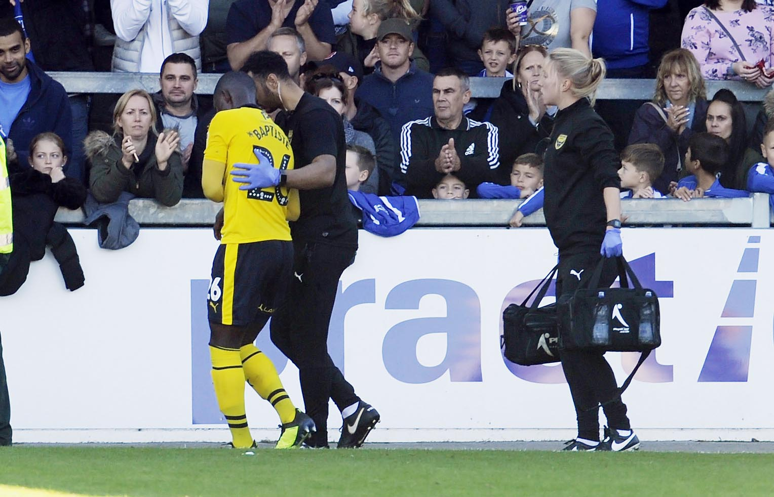 Shandon Baptiste is helped off the pitch by Oxford United's medical staff at Bristol Rovers  Picture: David Fleming