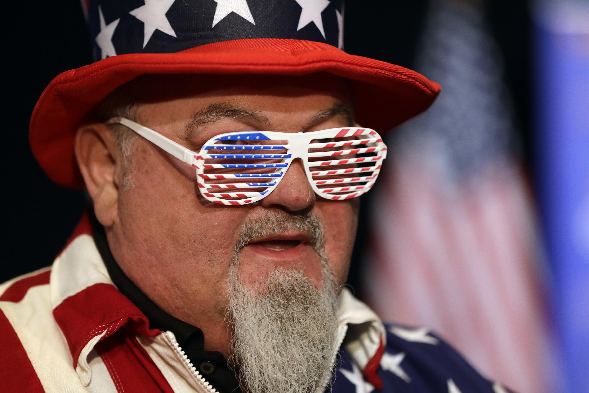 In Pictures: Costumes and crossed fingers as America heads to the polls